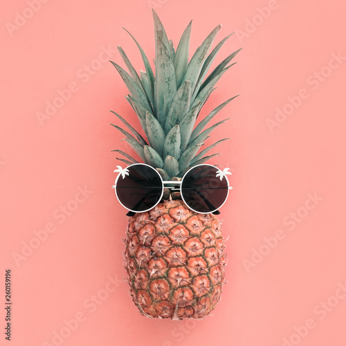 Pineapple fruit in sunglasses on pink pastel background - 260159196