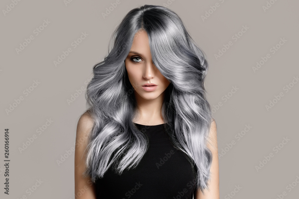 Fototapety, obrazy: Beautiful woman with long wavy coloring hair. Flat gray background.