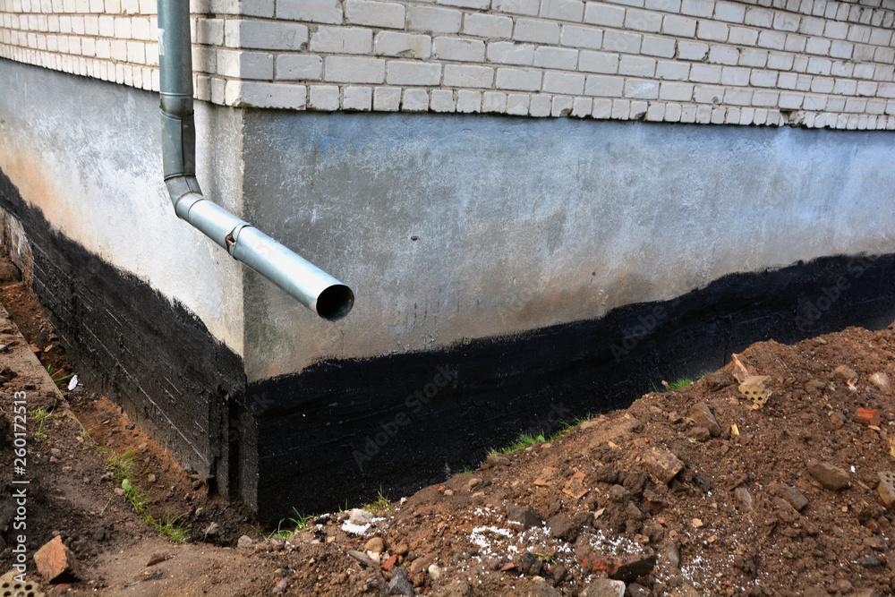 Fototapeta Waterproofing city flat house foundation with bitumen