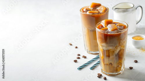 Two glasses of cold coffee on white background. Canvas Print