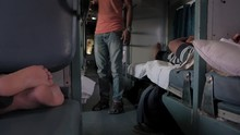 View Inside A Moving Train In Indian In The Sleeper Class As Most Of The People Travelers Are Resting And Sleeping In Their Beds