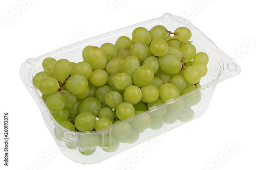 Fotografia Green  sweet grapes berries  in a clear plastic container isolated macro