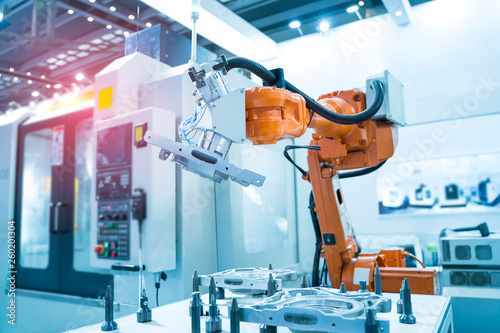 Fotografie, Obraz  robot arm is working smartly in the production department in artificial intellig