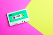 canvas print picture - Retro old school 80-s or 90-s concept. Audio cassette on a bright blue-pink background
