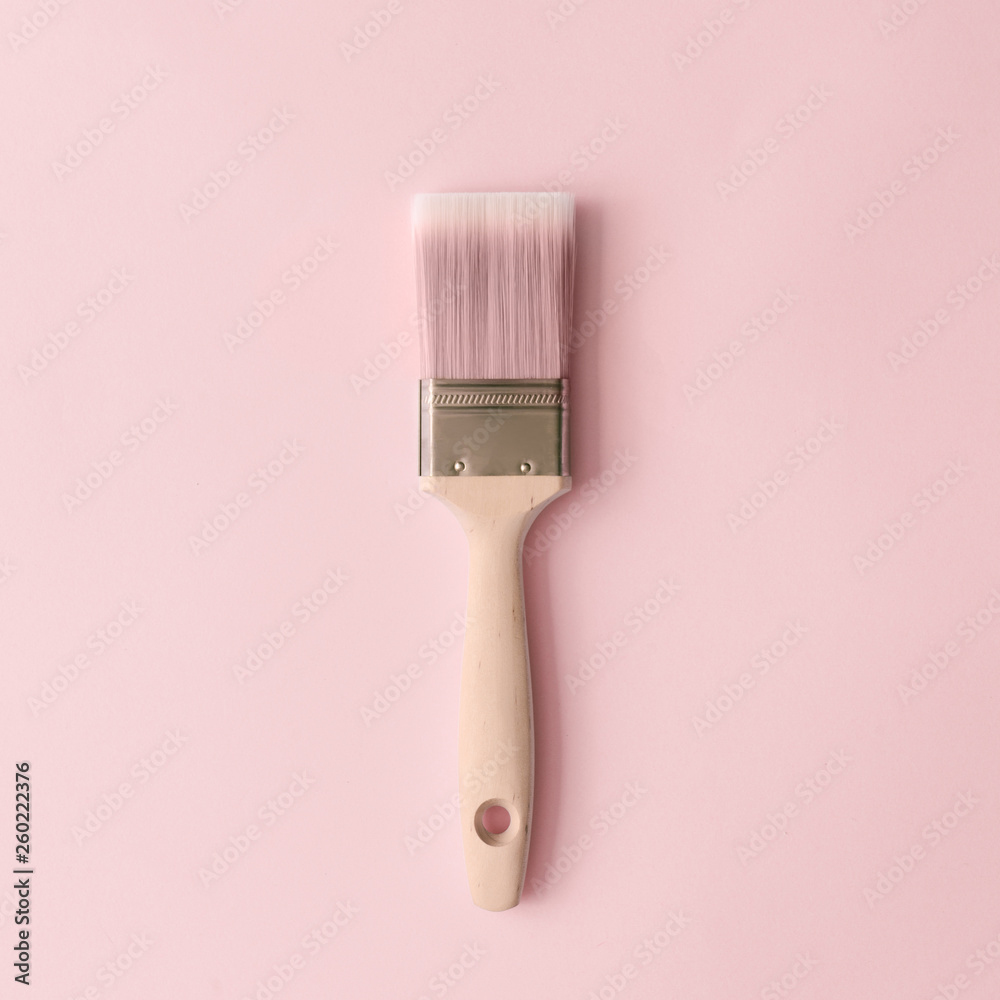 Fototapeta Creative concept made with paint brush and pastel pink background. Minimal flat lay.