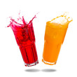 Couple orange juice and red soda splashing out of glass isolated on white background.