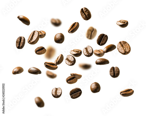 Foto op Plexiglas koffiebar Coffee beans in flight on white background
