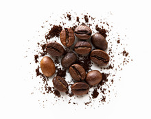 Coffee Beans And Scattered Milled Coffee On White Background