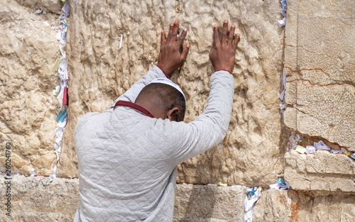 Fototapeta Undefined afro-american young man pray at the Western Wall. Jerusalem. Israel obraz