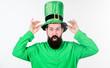 Leinwanddruck Bild - Myth of leprechaun. Man bearded hipster wear green clothing and hat patricks day. Saint patricks day holiday. Green color part of celebration. Happy patricks day. Global celebration of irish culture