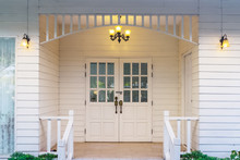 Typical Front Of Vintage Small White Wooden House With Vintage Lamp