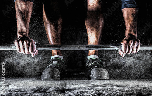 Fototapeta Male athlete preparing for barbell workout in gym. Weightlifting, power lifting training, fitness, sports concept. obraz