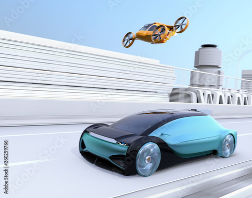 Yellow Self-driving Passenger Drone Taxi flying over a blue autonomous electric car driving on the highway Fototapet