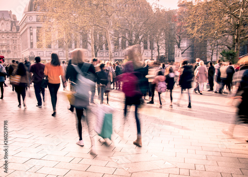 Motion blurred crowds of people in busy street scene Canvas Print