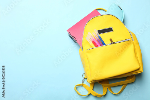 Obraz yellow backpack with different school supplies - fototapety do salonu
