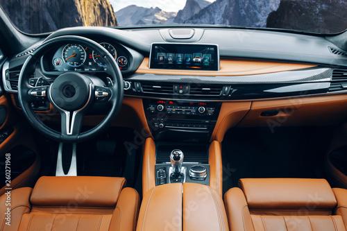 Obraz na plátně  Modern suv car interior with leather panel, multimedia and dashboard