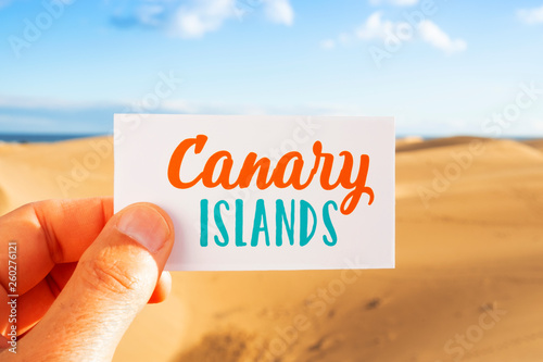 Fotografia  text Canary Islands in a sing, in dunes landscape