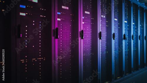 Cuadros en Lienzo Shot of Dark Data Center With Multiple Rows of Fully Operational Server Racks