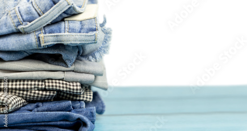 Obraz na plátně  Stacked clothes and pants on isolated white