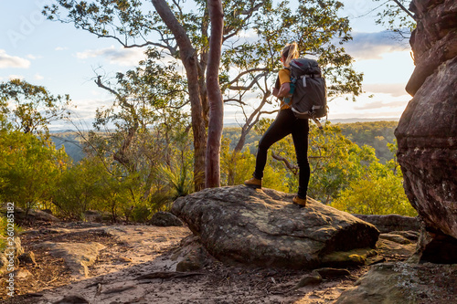 Fényképezés  Female bushwalker with backpack walking in Australian bushland
