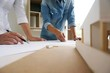 Engineering colleagues interior designer Corporate Achievement Planning Design on blueprint Teamwork Concept with compasses.