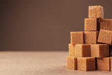 Brown Cane Sugar Cubes On A Li...