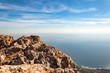 View from the top of AI-Petri mountain in Crimea, Russia. High rocks of Crimean mountains, black sea coast and blue sky with clouds.
