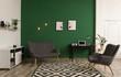 Leinwandbild Motiv Modern living room interior with workplace near green wall