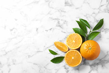 Flat Lay Composition With Ripe Oranges And Space For Text On Marble Background