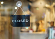 closed sign hanging outside a restaurant, store, office or other