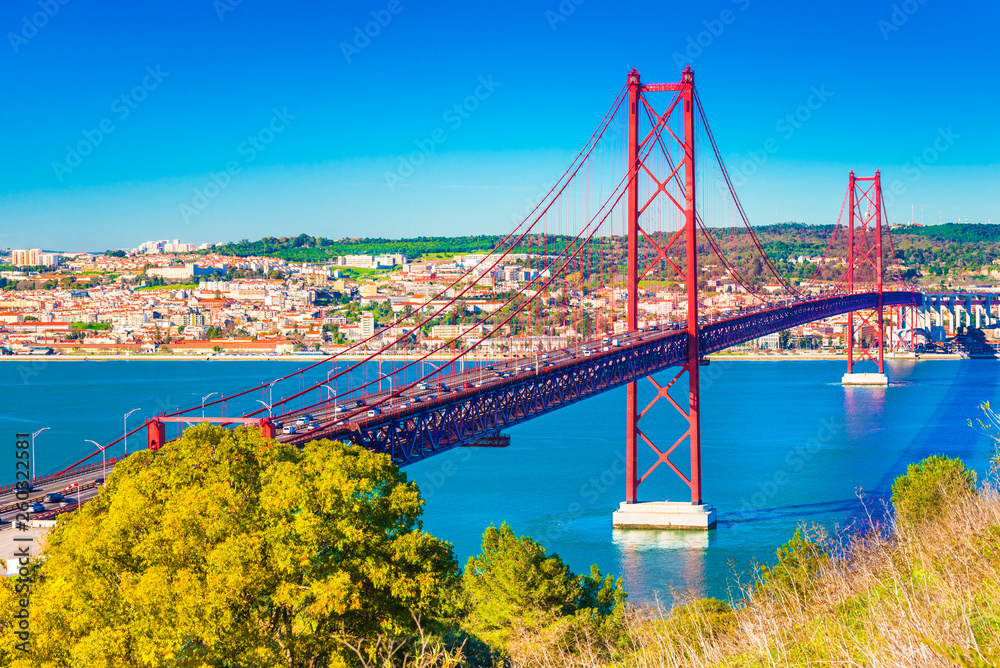 The 25th April Bridge (Ponte 25 de Abril) in Lisbon, Portugal. View from Almada