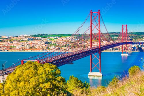 Fotografie, Obraz  The 25th April Bridge (Ponte 25 de Abril) in Lisbon, Portugal