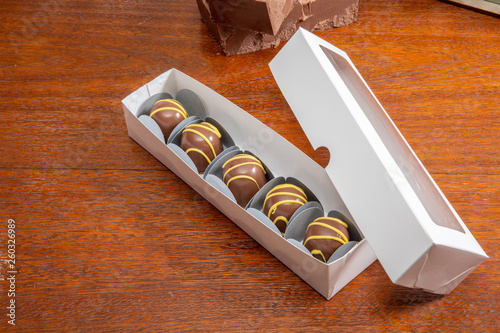 Canvas Prints Coffee beans Homemade chocolate truffles. Delicious sweet temptation. Covered with yellow cream.
