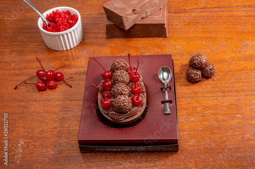 Fotografie, Obraz  Gourmet Easter egg, stuffed with creamy chocolate and red cherries