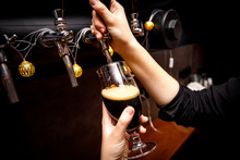 Female Bartender Hands Pouring...