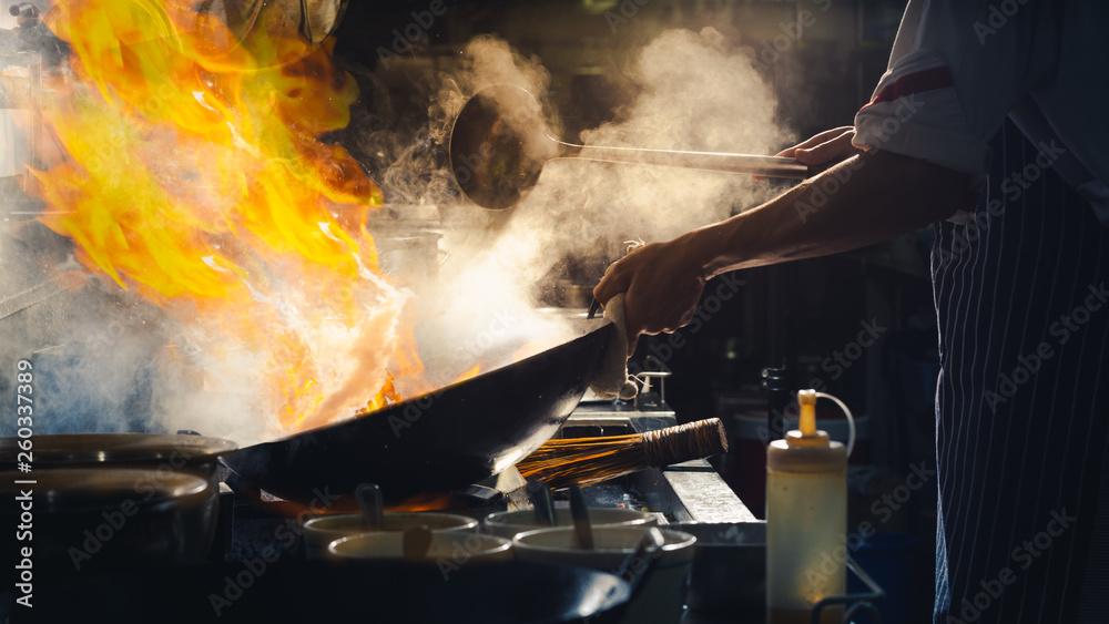 Fototapety, obrazy: Chef stir fry in wok