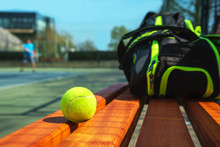 Tennis Ball And Sport Bag On The Bench On Court. Concept Of Sport, Healthy Lifestyle.
