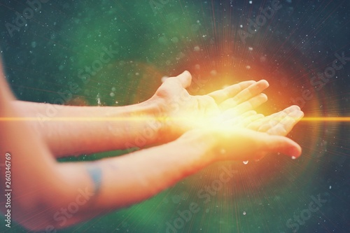 Fotografía  Woman hands praying for blessing from god, blurred nature background, rain, day