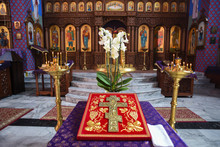 A Cross In The Church With An Iconostasis In The Background.