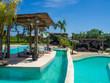 Disco ball reflecting green swimming pool. Bali.