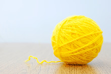 Yellow Ball Of Thread On A Lig...