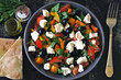 Middle Eastern salad with olives, feta and parsley. Healthy colorful vegetarian salad. Fresh arabic salad. Keto diet.