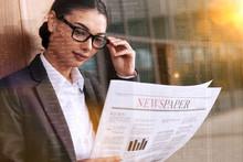 Businesswoman Reading Newspape...