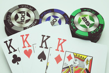 Four Kings And Many Color Poker Chips