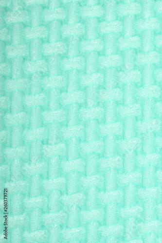 Photo  Texture of a polyethylene green shine gym mat. Yoga mat texture.