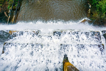 Looking Down At The Flow Of Water Falling Over A Concrete Dam, San Francisco Bay Area, California