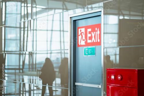 empty closed emergency exit door at airport Fototapeta