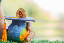 Student Hand Dropping Investing Bitcoin Money Coin To Graduation Fund For Save Moneys In Studying Abroad. Education Savings And Investment Ideas. Back To School, Studies Lead To Success For Knowledge