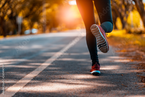 Leinwand Poster  athlete running sport feet on trail healthy lifestyle fitness