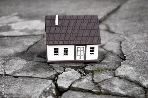 Canvas Print Model of house on cracked road outdoors. Concept of earthquake